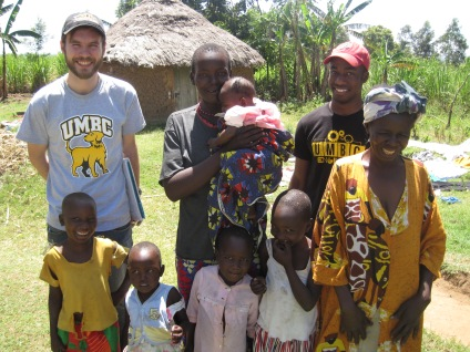 Dr. Blaney and Dalton Hughes with Evelyn Ayuma and her family.