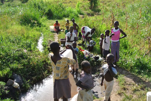 Villagers wash their laundry downstream from the water source.