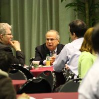 Keynote speaker George Mehaffy (center), Vice President for Academic Leadership and Change at the American Association of State Colleges and Universities, talks with UMBC Visual Arts professor Steve Bradley (left).